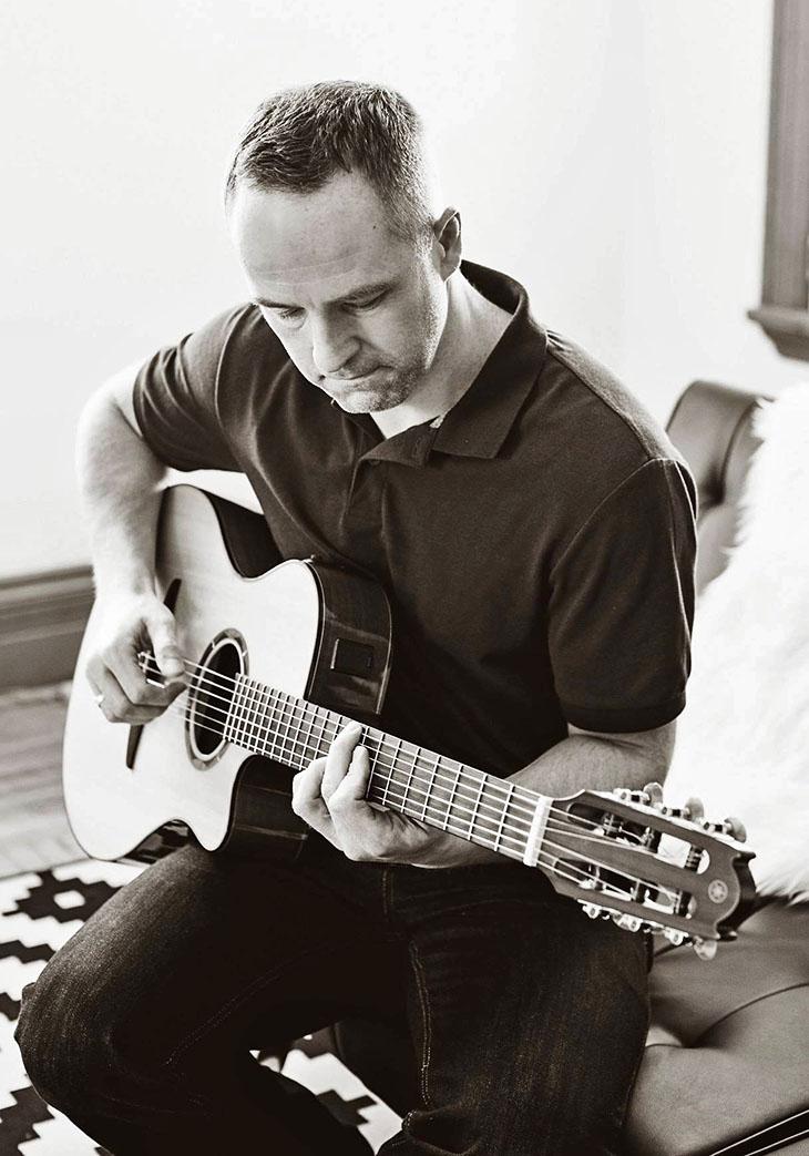 Paul Everett playing guitar